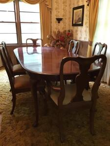 Queen Anne style mahogany finish table. Has two