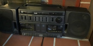 GE boombox cassette player.  Box of cassette