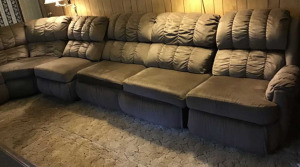 Brown sectional sofa.  Reclining ends. Bed