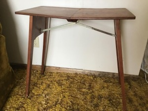 Folding mid century table, tapered legs.  30 inch